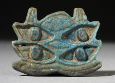 Multiple Eye of Horus Amulet  Egypt, 724 - 31 BCE  Jewelry and Adornments; amulets  Faience  Length: 1 in.