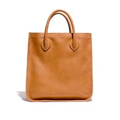 """This elegant carry-everything tote in rich leather is the very definition of versatile—there's even a removable shoulder strap, so you can wear it as a crossbody on days you've really packed it full. <ul><li>Leather.</li><li>Interior pocket.</li><li>4"""" handle drop.</li><li>13""""H x 12 1/2""""W.</li><li>Import.</li></ul>"""