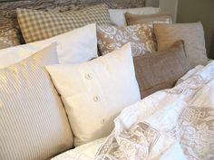 TEN pillows on ONE bed. This is very appealing to me.