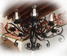 This is produced in various sizes. The chandelier is often used for illuminating high ceiling living rooms, foyer and house entries. Black Iron Chandelier, Iron Chandeliers, Hacienda Homes, Hacienda Style, Hotel Foyer, Ceiling Lamp, Ceiling Lights, High Ceiling Living Room, Iron Wall Decor