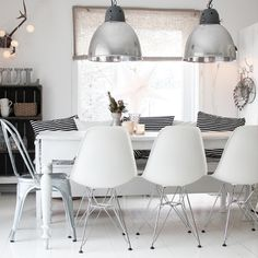 Eames and tolix chairs - and a bench with pillows. Considering this combo with a rustic farm table.