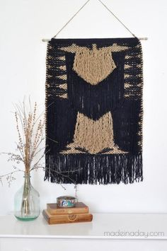 Here's a great tutorial from one of our readers who made this on-trend hanging tapestry from a store-bought rug. It's a great shortcut to DIY decor that won't leave you weaving for days. Large Tapestries, Hanging Tapestry, Tapestry Weaving, Wall Tapestry, Nudo Simple, Vintage Suitcase Table, Diy Vintage, Do It Yourself Inspiration, Easy Wall