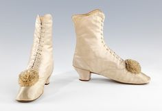 Evening boots. 1860-1869. french. silk  Shoes from this time period usually had a small heel or was flat. Decorative bows or rosettes adorned the footwear. Many ankle boots had elastic gores in order to make them more comfortable. These particular French boots were from around 1860-1869 and are made of silk.