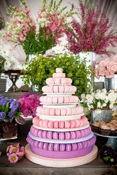 Macaroons, very fetch in the 20s....do whatever color to fit your wedding n dessert tables! Ombre macaron tower