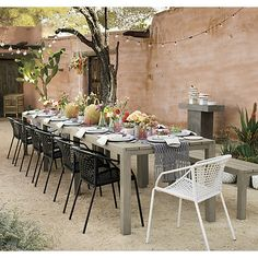 Create A Stylish Outdoor Space. With Colorful Outdoor Chairs And Tables,  Understated Seating And