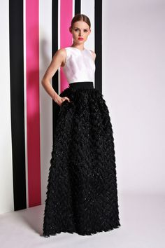 Blanc et noir is so elegant for evening. What every woman needs is a long black skirt which can be worn back with any number of tops. Christian Siriano Resort 2014