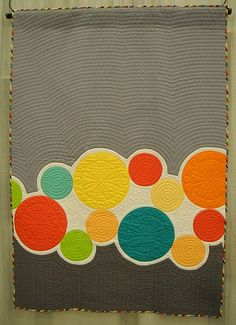 Gray and circles quilt.