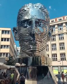 Prague, CZR: A Rotating Sculpture~ The twisting and reflective sculpture depicting the head of writer Franz Kafka is the latest kinetic artwork by Czech artist David Cerny. Located at Spalena Quadrio Shopping Center, which faces City Hall in Prague. Frank Kafka, Sculpture Metal, Street Art, Urbane Kunst, Prague Travel, Kinetic Art, Art Installation, Public Art, Wiener Dogs