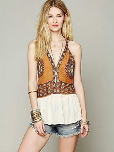Love the fact its a halter top that looks as it a vest;) Fashionista