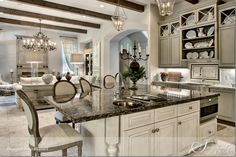 Bianco Romano and Luna Nero granites used as counter tops in this kitchen...