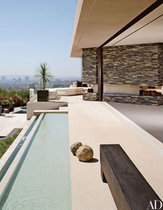 A rectilinear reflecting pool marks the front entrance to fashion designer Randolph Duke's hillside Los Angeles residence | archdigest.com