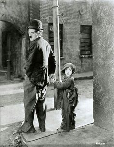 """Charlie Chaplin has always scared me but i like this picture! Charlie Chaplin and Jackie Coogan for Charles Chaplin Productions' """"The Kid"""" in (Unidentified photographer) Golden Age Of Hollywood, Vintage Hollywood, Hollywood Stars, Classic Hollywood, Charlie Chaplin, Silent Film Stars, Movie Stars, The Kid 1921, Charles Spencer Chaplin"""