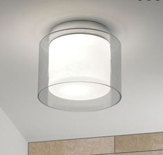 Astro Arezzo Polished Chrome Bathroom Ceiling Light A modern polished chrome bathroom ceiling fitting with white opal glass diffuser and clear outer glass shade. Bathroom Ceiling Light, Flush Ceiling Lights, Ceiling Light Fixtures, Astro Lighting, Hall Lighting, Lighting Ideas, Lighting Design, Contemporary Bathroom Lighting, Verre Design