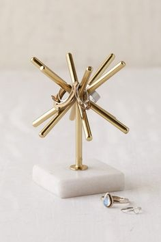 Decor/accessories - Gold sunburst design ring stand with white marble base. Complete with 5 rods for keeping your rings safe + secure. Great decor piece, too! Jewellery Storage, Jewellery Display, Jewelry Organization, Earring Storage, Jewelry Holder Stand, Ring Holders, Rangement Makeup, Ring Stand, Home And Deco