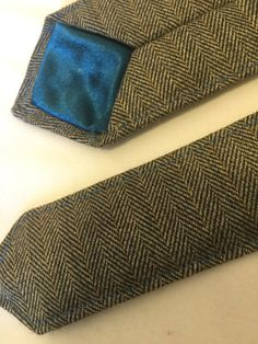 Handmade Bespoke Tweed Skinny Designer Tie with Contrasting Teal Blue 1mm Edge Stitch and Tipping    These products can also beproduced to order and manufactured to suit individual requirements. The styles illustrated contain some of the features possible when designing a Great British Bespoke Custom Tie, please contact our sales office for further assistance and a specific quotation.    Look At This -https://www.youtube.com/channel/UCsP3gGTj3lSynhpb2itF5rA    Perfect to treat yourself or…
