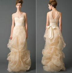 Vera Wang - Gabriella.  A stretch charmeuse V-neck mermaid gown allures with an illusion corset top, cut blossom skirt, dreamy tulle overlay and finely woven trim.