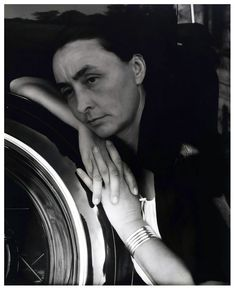 Alfred STEIGLITZ :: Georgia O'Keefe with hands on back tire of Ford V8, 1933  #portrait