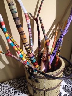 A bucket of painted sticks by Claire: acrylic paint and markers.