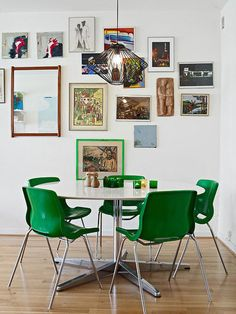 Love this idea for a small eat in kitchen! Break up the dining space/cooking space with neat pictures!