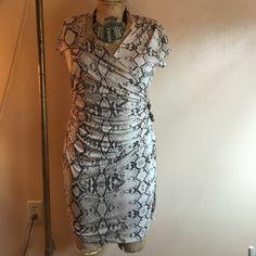 Jennifer Lopez snake print dress This is a brand new, never worn Jennifer Lopez snake skin print dress. New without tags. Size large. Jennifer Lopez Dresses Midi