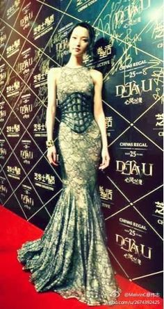 Du Juan wearing Alexander McQueen Barnacle lace fishtail dress & leather cage corset