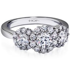 Hearts on Fire. Beloved three-stone engagement ring.