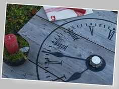 12 Terrific DIY Table Transfers - The Graphics Fairy - This fab rustic table was shared by Nik at NikAntik, and has been a long time favorite of mine! So lovely for on a porch or patio! She cleverly used the French Clock Face.
