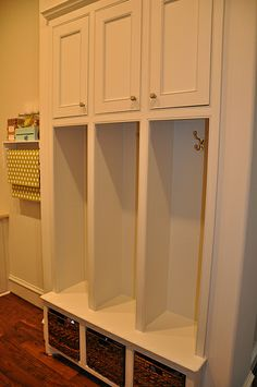 built ins.......if the tall part had doors it would be like lockers. A place to stash your bag, purse, coat, etc..... What an awesome idea