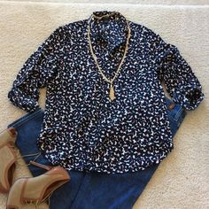Ann Taylor button front blouse Ann Taylor button front blouse. Navy with designs with little red leaves throughout. Sleeves can be rolled and cuffed. 2 pockets on the chest. 100% polyester. Super soft, feels like cotton/silk. Size S. Excellent condition. Ann Taylor Tops Blouses