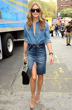 Olivia Palermo rocked the double denim style with a split pencil skirt with a denim button-up top. She paired the look with nude sandals and a black and cream doctor bag.