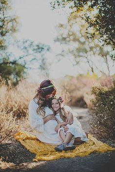 Mother-daughter maternity photos.
