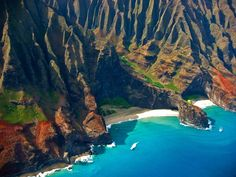 Kalalau and Honopu Beaches in Kauai's Na Pali Coast. Only accessible by hiking or kayaking. One of the most beautiful places I have ever been.