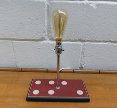 DOMINO TABLE LAMP Quirky table lamp made from an over-sized wooden domino base New chrome up-stand and switched bulb holder to top of bulb holder All our items are pre-owned and vintage, so may have light signs of use & wear typical of age. Domino Table, Lamps, Chrome, Table Lamp, Bulb, Signs, Vintage, Lightbulbs, Table Lamps