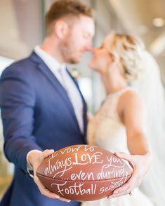 "Couple holding football that says ""I vow to always love you even during football season"" {OHIO WEDDING PHOTOGRAPHER}"
