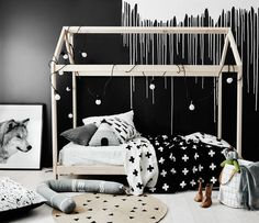 A Nordic Bedroom for Children with Simple Monochrome Interior