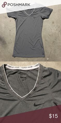 Nike Pro Dri-Fit Workout Tee This Nike Dri-Fit v neck T is in perfect shape with no stains. Only worn once. It's a longer cut that hits a little below the waist. Let me know if you have any questions. Nike Tops Tees - Short Sleeve
