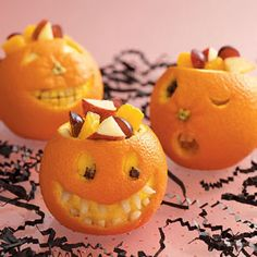 Jack-o'-Lantern Oranges Recipe- Recipes  This is a great way to get the kids to eat nourishing fruit during the candy-laden Halloween season. They can even help cut up the apples and grapes with plastic knives and decide how they want their fancy orange to look!—Taste of Home Test Kitchen
