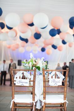Bride & Groom chairs + paper lanterns! Photography: Bia Sampaio Photographs…