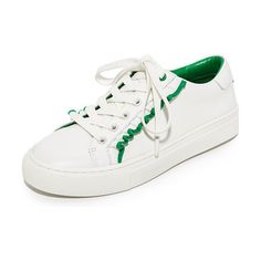 tory sport ruffle sneakers by Tory Burch. Striped ruffles add a charming touch to these sporty Tory Burch sneakers. Tonal lace-up closure. Rubber sole. Leather...