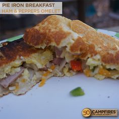 Pie Iron Breakfast: Ham Omelet - love making these over the campfire! #camping #recipes