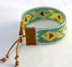 Bayou Woman Fish Bracelet, available for purchase at https://www.etsy.com/listing/212631936/bayou-woman-bead-loomed-fish-bracelet?ref=shop_home_active_1