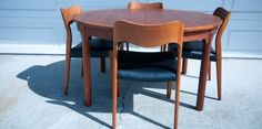 """not crazy about the cylindrical legs, but love the look opened up.     Mid Century Dining Table by Borge Mogensen for Karl Andersson & Soner. This piece was solidly constructed in teak with brass accents. This table extends with two butterfly leaves that store underneath when not in use. In good condition with minimal vintage wear. Chairs are sold separately.  Dimensions: 51"""" Diameter, 28"""" H; 85"""" fully extended  $1800"""