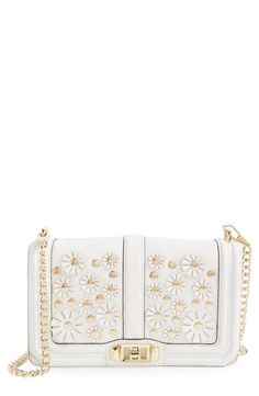 This crisp, white and gold crossbody bag from Rebecca Minkoff is too adorable!