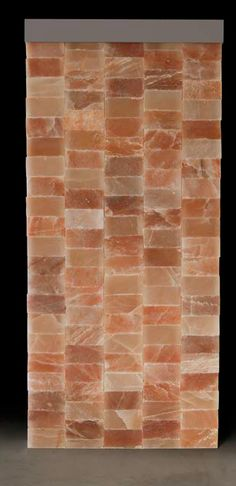 Backlighted salt wall made with Himalayan salt bricks and automatic and manual LED chromotherapy. Carmenta Wellness - Halotherapy
