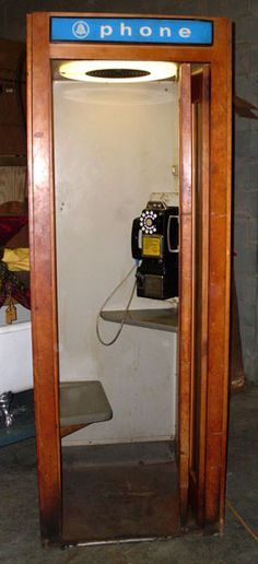 phone booth - Hard to find a public phone at all these days.  For sure, these old booths are a thing of the past.  I used to play in the one at the laundromat.  Felt like I was in my own world.