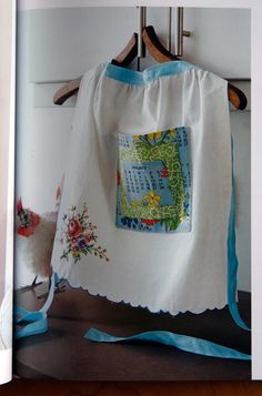 Vintage pillowcase apron Looks like the pocket is made out of those fabric calendars. #DIYiLoveThis