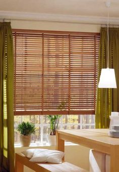 window dressings in green white orange and browns beautiful bamboo blinds for interior decorating and