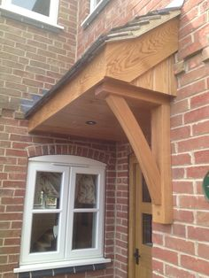 Kiln dried Oak canopy over the front door. Oak Front Door, Green Front Doors, Front Door Porch, Front Porch Design, Garage Door Design, Porch Roof, House Front, Front Porches, Over Door Canopy