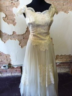 1940'S Wedding dress, with a tulle bottom and impeccable lace detailing, in great condition. www.therufflifelingerie.com
