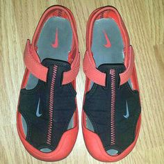 Size: 1y Brand: Nike EUC Unisex for girls or boys Red & Black Shoes. Barely worn. Have rubber sole just like a sneaker! Velcro closure across the ankle for easy on easy off.